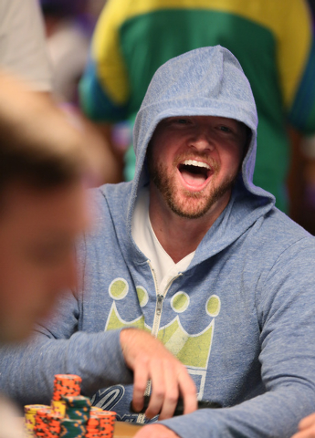 Christopher Shaw reacts to a hand played during the 2014 World Series of Poker at the Rio hotel-casino Saturday, July 12, 2014, in Las Vegas. The $10,000 No-Limit Hold 'em World Championshi ...