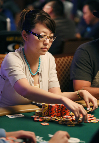 Darlene Lee collects her chips after a winning a hand Saturday during the World Series of Poker Main Event at the Rio Convention Center. Lee was one of four women remaining in the tournament at th ...
