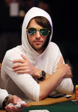 Poker player Patrick Coughlin watches play at his table during the 2014 World Series of Poker at the Rio hotel-casino Saturday, July 12, 2014, in Las Vegas. The $10,000 No-Limit Hold 'em Wo ...
