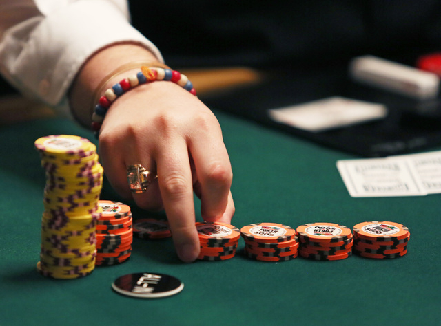 A dealer counts chips during Day 5 of the World Series of Poker Main Event at the Rio Convention Center on Saturday. Brazilian Bruno Politano had more than 5.2 million chips and was in the lead at ...