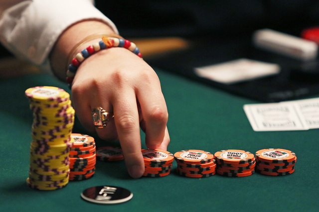 A dealer counts chips during the 2014 World Series of Poker at the Rio  hotel-casino Saturday, July 12, 2014, in Las Vegas. (Ronda Churchill/Las  Vegas Review-Journal) | Las Vegas Review-Journal