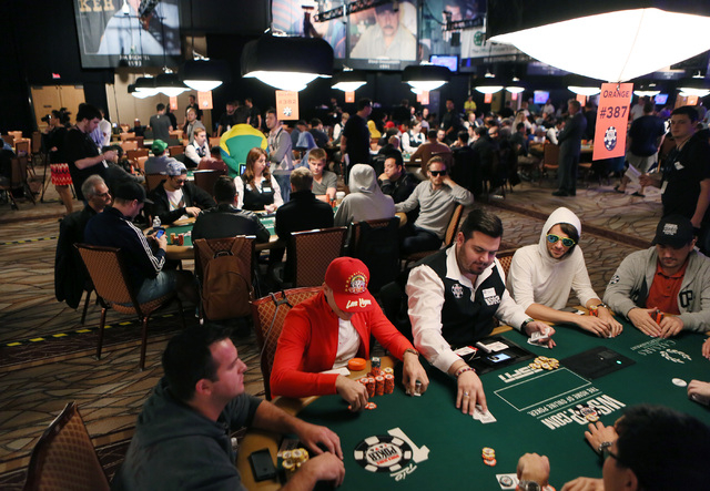 Day 5 of the main event takes place at the 2014 World Series of Poker at the Rio hotel-casino Saturday, July 12, 2014, in Las Vegas. The $10,000 No-Limit Hold 'em World Championship runs fr ...