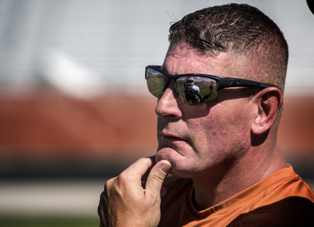 New Legacy High football coach John Isola watches intently during practice Tuesday. The Longhorns will begin their season next Friday with a game at St. George, Utah. (Jeff Scheid/Las Vegas Review ...