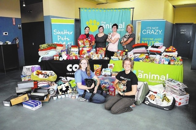 On July 16, Cox Communications presented the results of a two-week Cuddle & Snuggle Pet Needs Drive, which included items donated from employees and a $1,000 check to The Animal Foundation. (Speci ...