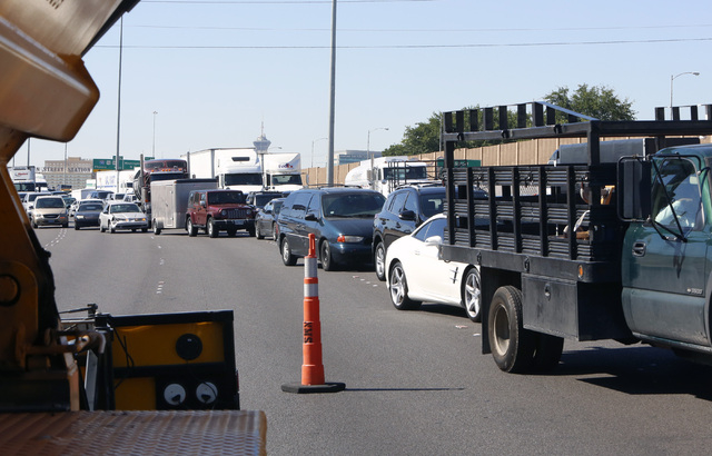 Motorists approach the accident scene near Lake Mead on I-15 North on Thursday, Aug 28, 2014 in North Las Vegas.  All but one lane of northbound Interstate 15 was closed to motorists after a crash ...