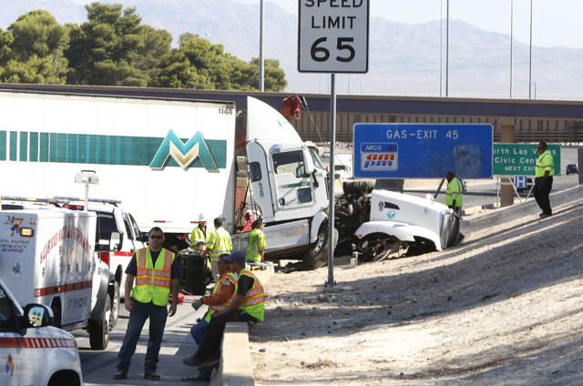 Hazardous material response team are seen at the accident scene near Lake Mead on northbound Interstate-15 on Thursday, Aug 28, 2014, in North Las Vegas. All but one lane of I-15 was closed to mot ...