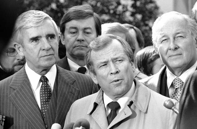 This Feb. 11, 1982 file photo shows the late Senate Majority Leader Howard Baker of Tenn., center, flanked by Sen. Paul Laxalt, R-Nev., left, and House Minority Leader Robert Michel of Ill. outsid ...