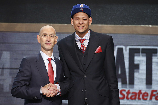 Baylor center Isaiah Austin, right, poses for a photo with NBA Commissioner Adam Silver after being granted ceremonial first round pick during the 2014 NBA draft, Thursday, June 26, 2014, in New Y ...