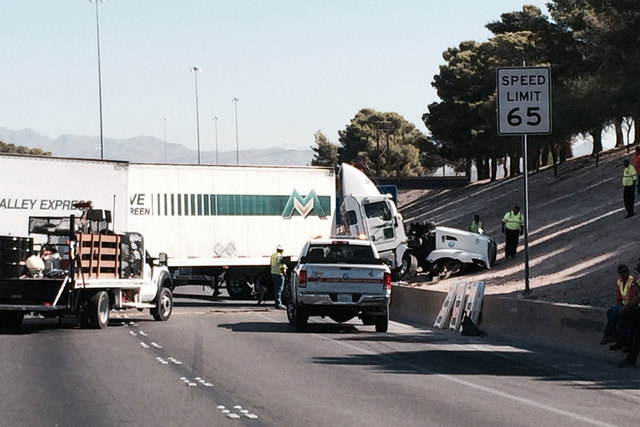 Traffic was restricted to one lane on northbound Interstate 15 on Thursday morning after a crash involving a semitrailer and two other vehicles. (Bizu Tesfaye/Las Vegas Review-Journal)
