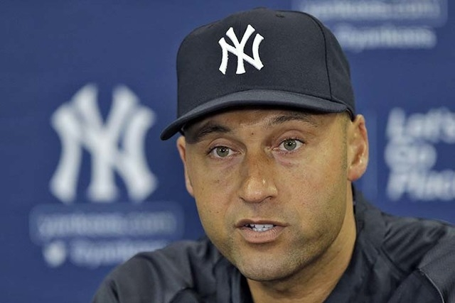 New York Yankees shortstop Derek Jeter answers a question during a news conference in Tampa, Fla. Jeter, saluted at the All-Star game and making a long goodbye this season, finishes his baseball l ...