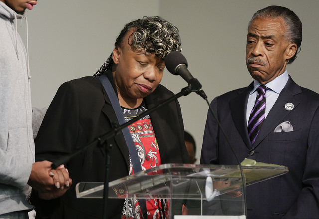 Gwen Carr, left, mother of Eric Garner, speaks as Rev. Al Sharpton looks on during a rally, Saturday, Aug. 2, 2014, in New York. The rally was held to  address the medical examiner's report that c ...