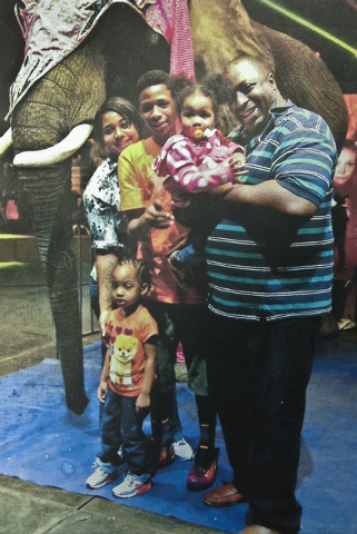 FILE- In this undated family file photo provided by the National Action Network, Saturday, July 19, 2014, Eric Garner, right, poses with his children during a family outing. On Friday, Aug. 1, 201 ...