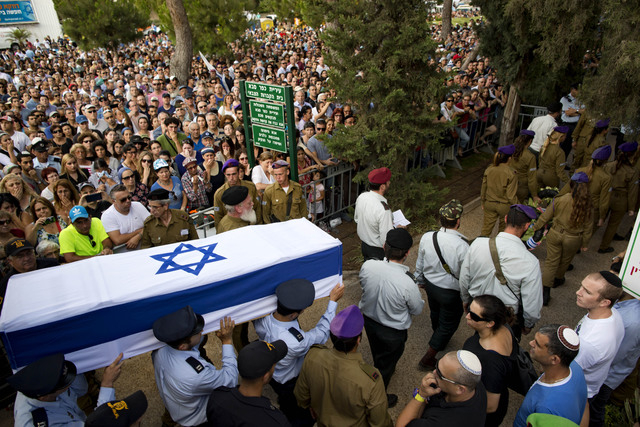Israeli soldiers carry the coffin of Israeli Army 2nd. Lt. Hadar Goldin during his funeral at the military cemetery in the central Israeli city of Kfar Saba on Sunday, Aug. 3, 2014. Israel announc ...