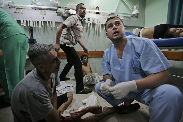 Palestinians, wounded in an Israeli strike at a house in Beit Lahiya, northern Gaza Strip, lie on the floor as they receive treatment, at the emergency room of the Kamal Adwan Hospital, in Beit La ...
