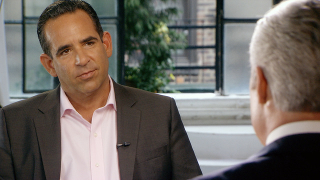 In this undated image taken from video and provided by 60 minutes, Biogenesis founder Anthony Bosch, left, talks with 60 Minutes correspondent Scott Pelley. Federal authorities are charging the ow ...