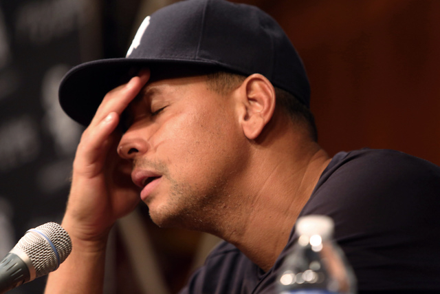 FILE - In this Aug. 5, 2013 file photo, New York Yankees' Alex Rodriguez, with his hand to his head, talks during a news conference before the Yankees played the Chicago White Sox in a baseball ga ...