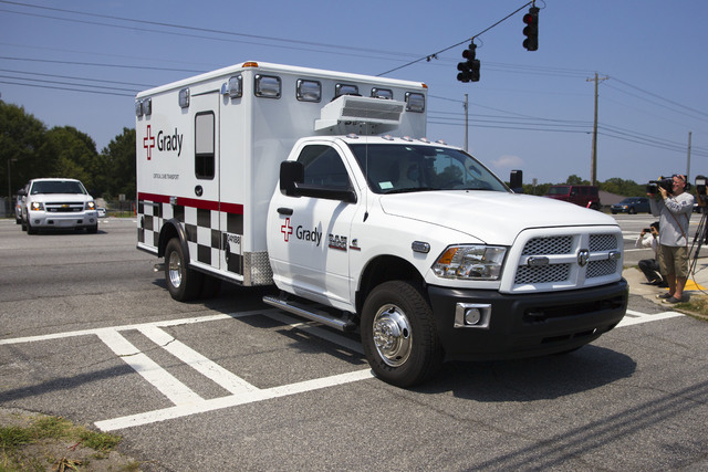 An ambulance leaves Dobbins Air Reserve Base transporting Nancy Writebol, the second American missionary stricken with Ebola, Tuesday, Aug. 5, 2014, in Marietta, Ga. Writebol was admitted to Atlan ...