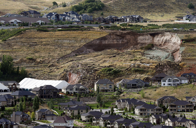 This Tuesday, Aug. 5, 2014 photo shows the area of a landslide in a hillside community of North Salt Lake, Utah. One home has been destroyed and at least a dozen others have been evacuated. (AP Ph ...
