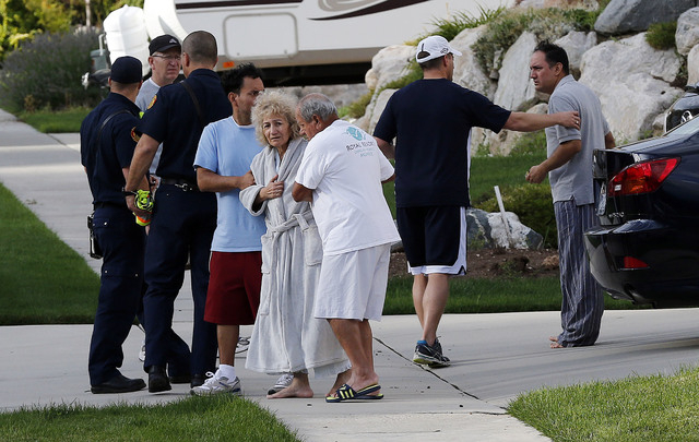Residents are evacuated following a landslide in a hillside community of North Salt Lake, Utah, Tuesday, Aug. 5, 2014. One home has been destroyed and at least a dozen others have been evacuated.  ...