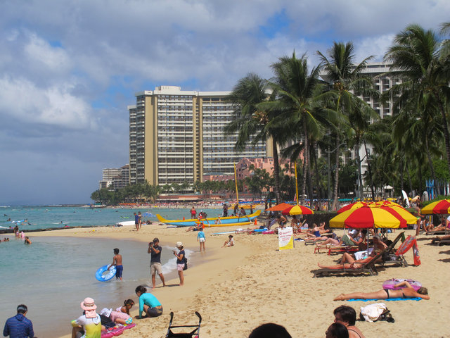 People lounge on Waikiki's beaches in Honolulu on Wednesday, Aug. 6, 2014. Hawaii residents prepared for what could be the first hurricane to hit the state in more than 20 years as weather officia ...