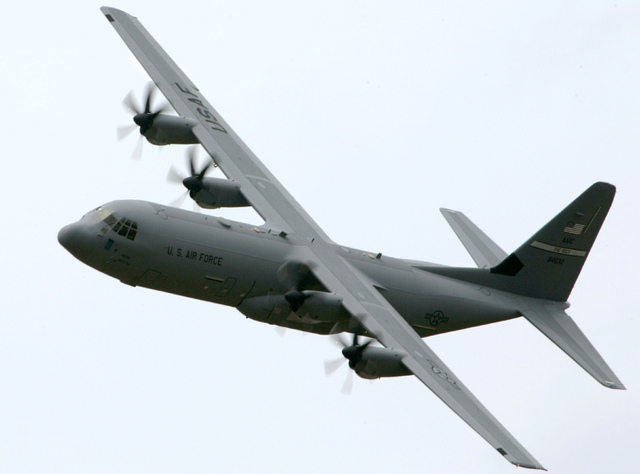FILE - This June 20, 2007, file photo shows a C-130-J transport aircraft over Little Rock Air Force Base in Jacksonville, Ark. President Barack Obama authorized U.S. airstrikes in northern Iraq, T ...