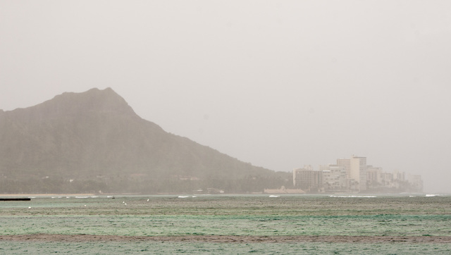 Rain falls on Diamond Head and Waikiki in Honolulu on the island of Oahu on Friday, Aug, 8, 2014. Iselle came ashore onto the Big Island early Friday as a weakened tropical storm, while Hurricane  ...