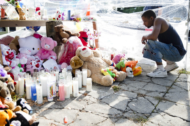 Richard Starchia pays his respects at a makeshift memorial for three children who were killed by a hijacked car that lost control and hit a group of people in north Philadelphia on July 28, 2014.  ...