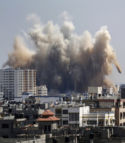 Smoke, dust and debris rise over Gaza City after an Israeli strike, Friday, Aug. 8, 2014, as Israel and Gaza militants resumed cross-border attacks after a three-day truce expired and Egyptian-bro ...
