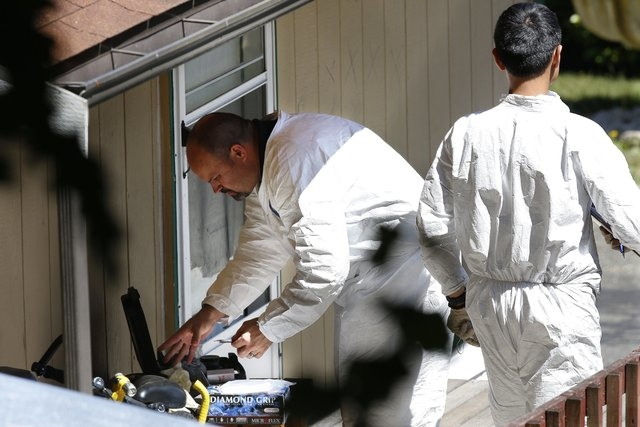 Investigators work at the home of Jenise Wright in the Steele Creek Mobile Home Park in East Bremerton, Wash., on Thursday, Aug. 7, 2014.  Law enforcement officers searching for  6-year-old Jenise ...