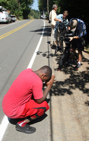 Ronald Newton prays along side Old Military Rd. for missing Stele Creek Mobile Home Park resident Jenise Wright,6, on Thursday, Aug. 7, 2014, after word got out that remains were found in the vici ...