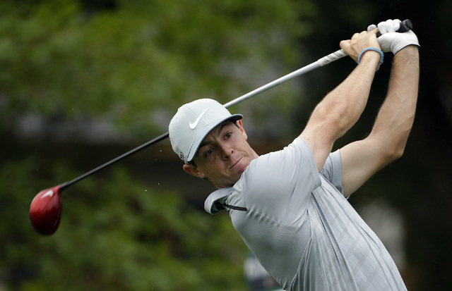 Rory McIlroy, of Northern Ireland, watches his tee shot on the 10th hole during the second round of the PGA Championship golf tournament at Valhalla Golf Club on Friday, Aug. 8, 2014, in Louisvill ...