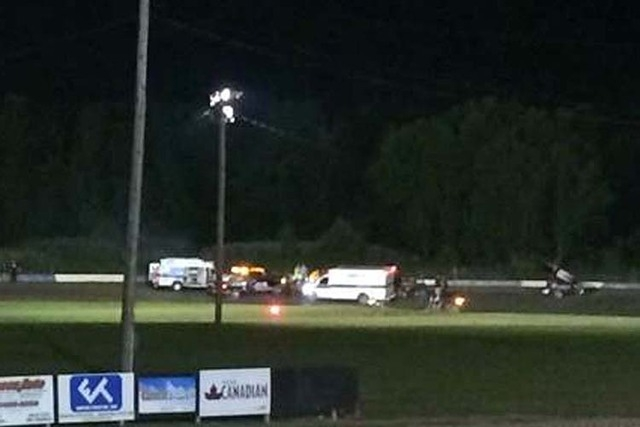 This image provided by Logan Messerly shows ambulances on the scene at Canandaigua Motorsports Park on Saturday Aug. 9, 2014 in Canandaigua, N.Y. Authorities are investigating a serious crash that ...
