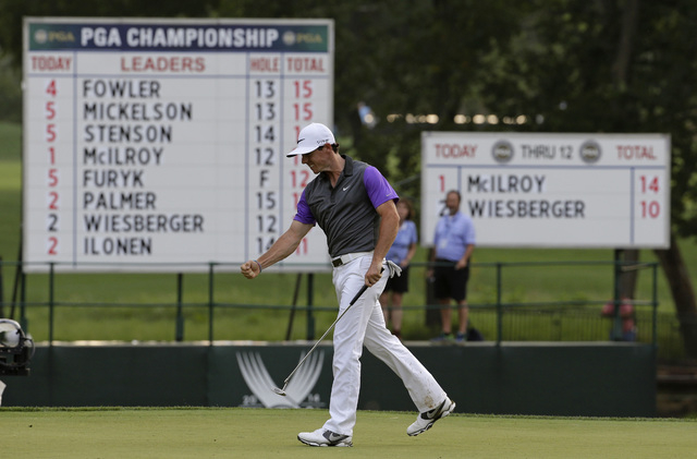 Rory McIlroy, of Northern Ireland, celebrates a putt on the 13th hole during the final round of the PGA Championship golf tournament at Valhalla Golf Club on Sunday, Aug. 10, 2014, in Louisville,  ...
