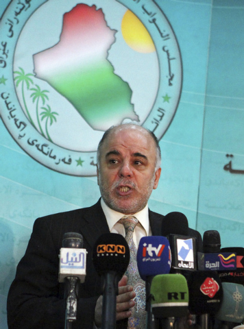 Shiite lawmaker Haider al-Abadi speaks to the press in Baghdad, Iraq, on Dec. 5, 2009. On Monday, Aug. 11, 2014, Iraq's largest coalition of Shiite political parties chose the al-Ibadi to be its c ...