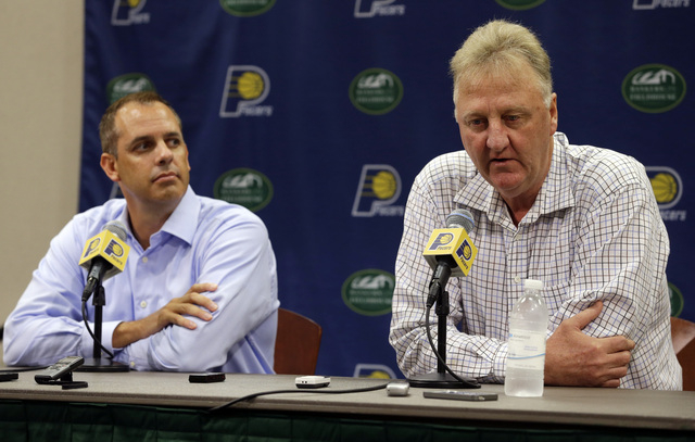 Indiana Pacers President of Basketball Operations Larry Bird, right,  and head coach Frank Vogel talk about the injury to player Paul George during a press conference in Indianapolis, Tuesday, Aug ...