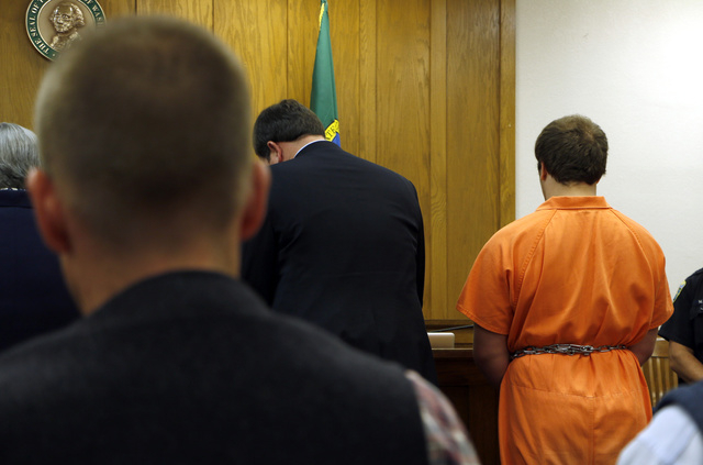 Gabriel Gaeta, right, stands next to his lawyer at a hearing in Kitsap County Superior Court, on Monday, Aug. 11, 2014, in Port Orchard, Wash. A judge found probable cause to detain the 17-year-ol ...