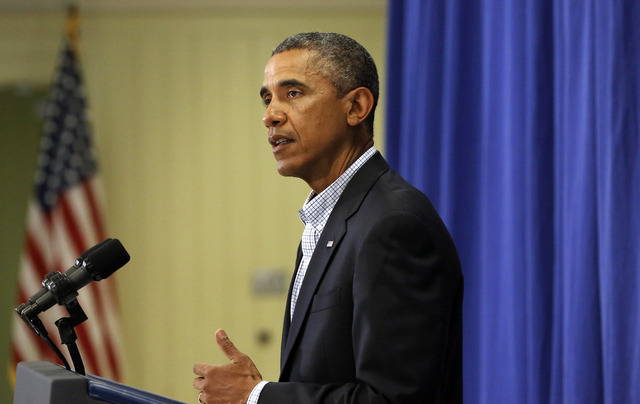 President Barack Obama speaks to reporters, Thursday, Aug. 14, 2014, in Edgartown, Massachusetts, about developments in the police shooting of 18-year-old Michael Brown in Ferguson, Mo. (AP Photo/ ...