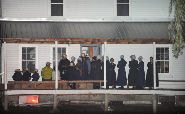 Supporters gather on the porch of a house in Heuvelton, N.Y., on Thursday, Aug. 14, 2014, after Fannie Miller, 12, and her sister Delila Miller, 6, were returned home safely after being abducted W ...