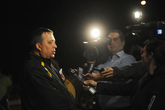 St. Lawrence County Sheriff Kevin M. Wells addresses the media Thursday night, Aug. 14, 2014, in Heuvelton, New York, after Fannie Miller, 12, and her sister Delila Miller, 6, were returned home s ...