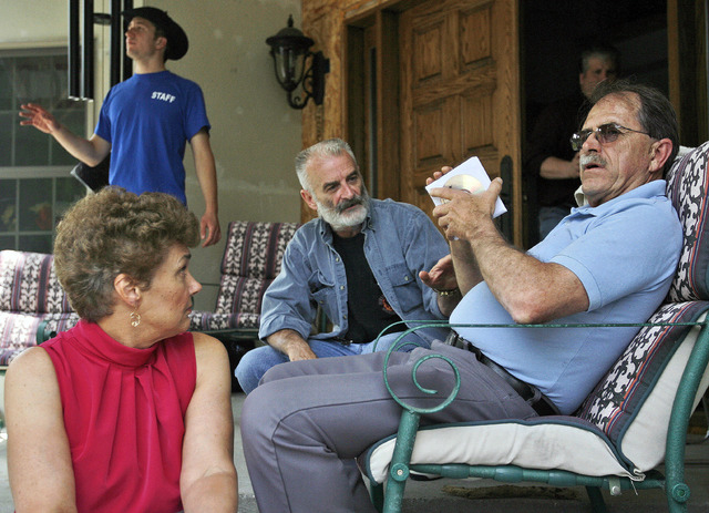 Ed Brown, right, and his wife, Elaine Brown, listen to Ruby Ridge survivor Randy Weaver, center, at their home in in Plainfield, New Hampshire, on  June 18, 2007. The tax-evading couple are servin ...