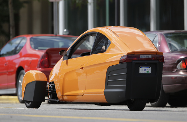 The Elio A Three Wheeled Prototype Vehicle Is Shown In Traffic Royal