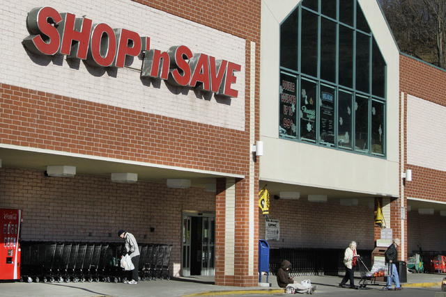 FILE  - In this Jan. 9, 2012 file photo, customers exit a Shop' Save grocery store in Mount Lebanon, Pa.  Supervalu said Friday, Aug. 15, 2014,  that a potential data breach may have impacted abou ...