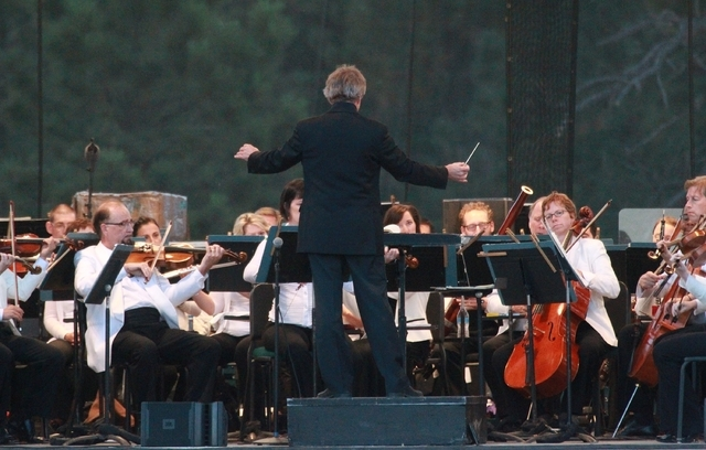 Music Director Thierry Fischer conducts the Utah Symphony Friday, Aug. 15, 2014, at the edge Bryce Canyon National Park, Utah. The Utah Symphony hopes to complement the beauty of Utah's soaring re ...