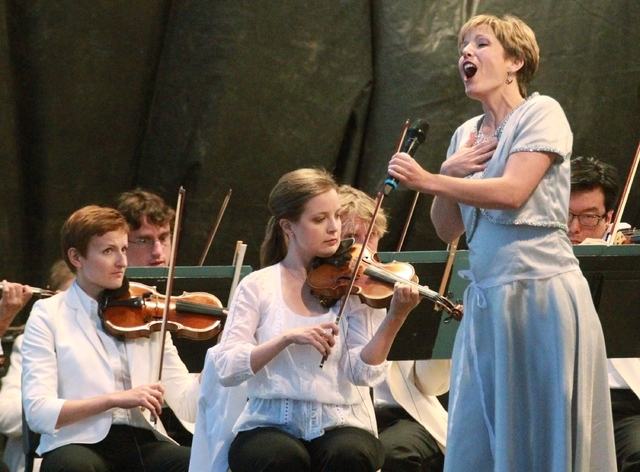 The Utah Symphony performs Friday, Aug. 15, 2014, at the edge Bryce Canyon National Park, Utah. The Utah Symphony hopes to complement the beauty of Utah's soaring red rocks and canyons with free d ...