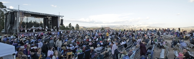 The audience takes their seat before the start of the Utah Symphony performance Friday, Aug. 15, 2014, at the edge Bryce Canyon National Park, Utah. The Utah Symphony hopes to complement the beaut ...