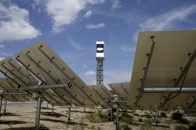 Mirrors, in foreground, reflect sunlight onto a power tower at the Ivanpah Solar Electric Generating System near Primm, Aug. 13, 2014. New estimates for the plant near the California-Nevada border ...