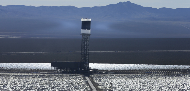 FILE - This Feb. 11, 2014 file photo shows some of the 300,000 computer-controlled mirrors, at the Ivanpah Solar ElectirIc Generating System in Primm, Nev. New estimates for the Ivanpah solar plan ...
