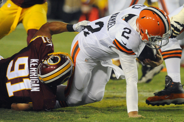 Washington Redskins outside linebacker Ryan Kerrigan (91) sacks Cleveland Browns quarterback Johnny Manziel (2) during the first half of an NFL preseason football game Monday, Aug. 18, 2014, in La ...
