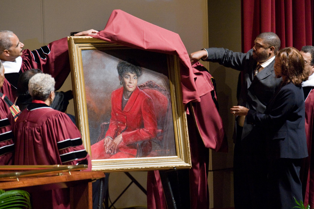 This March 25, 2009 file photo shows Attorney General Eric Holder, left, and Vivian Malone Jones' children, Michael Anthony and Monica Alicia, right, unveiling a portrait  of Jones Malone, first A ...