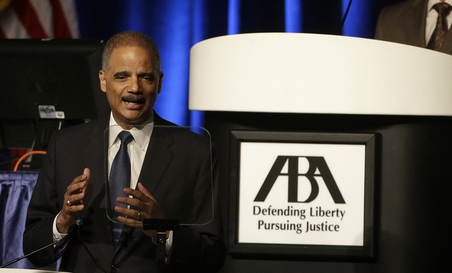 This Aug. 12, 2014 file photo shows Attorney Gen. Eric Holder speaking to the American Bar Association Annual Meeting in San Francisco. In remarks to the association, Holder said the Obama adminis ...